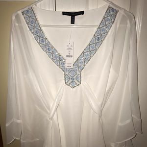 White Top with Bead Detailing